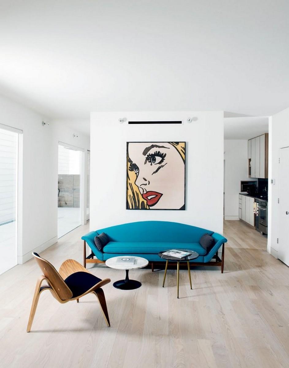 Diseño Moderno: Proyectos minimalistas que puedes encuentrar la simplicidad diseño moderno Diseño Moderno: Proyectos minimalistas que puedes encuentrar la simplicidad white wall blue couch pop art minimalism 768x977 1